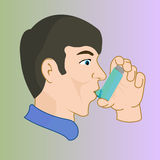 A man with an inhaler, medication through an inhaler Royalty Free Stock Images