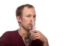Man with inhaler Royalty Free Stock Photography