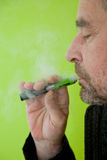 Man inhaling from an electronic cigarette Stock Images