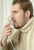 Man Inhaling Through Inhaler Mask Royalty Free Stock Photos