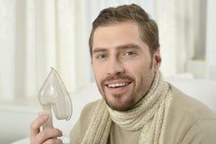 Man Inhaling Through Inhaler Mask Royalty Free Stock Photography
