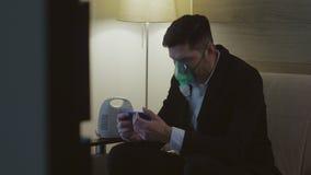 A person inhales through an inhaler mask