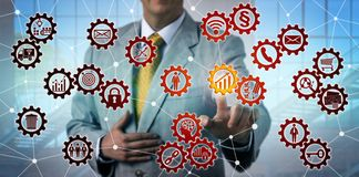 Man Initiating Growth Icon In Virtual Gear Train royalty free stock photo