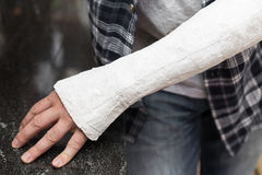 Man with injured arm. Is leaning at a table stock images