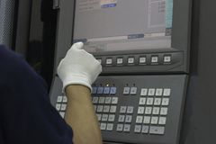 Man input data on cnc machine panel control royalty free stock photo