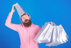 Man with insane look and open mouth wearing silver paper bag on his head. Shopaholic going crazy about seasonal sales. Shopping concept. Bearded man in pink stock photography