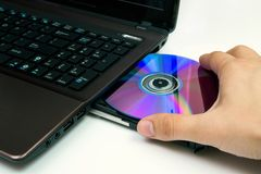 Man insert compact disc Stock Photo