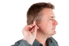 Man inserting a hearing aid into ear Stock Photos