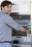 Man inserts card in the ATM Stock Photo