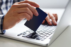 Man inserts the data for online payment Royalty Free Stock Image