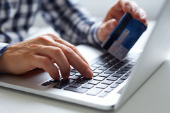Man inserts data for online payments Stock Images