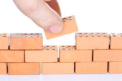 Man inserts the last brick Stock Photography