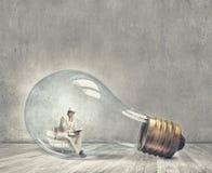 Man inside bulb Stock Photo
