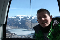 Man inside the cabin. Cable car in Zell am See, skiing resort in North Tirol, Austria. Royalty Free Stock Photo