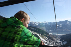 Man inside the cabin. Cable car in Zell am See, skiing resort in North Tirol, Austria. Stock Photos