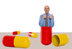Man inside a capsule feeling great Royalty Free Stock Photo