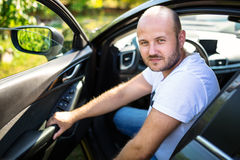 Man inside the car. Portrait of a man inside his car Royalty Free Stock Photos