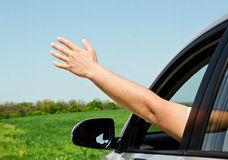 Man inside car showing his hand Royalty Free Stock Image