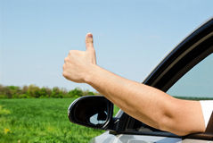 Man inside car showing thumb up Stock Photography