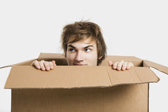 Man inside a card box Royalty Free Stock Images