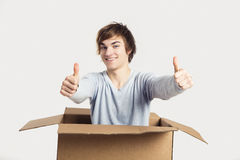 Man inside a card box Stock Image