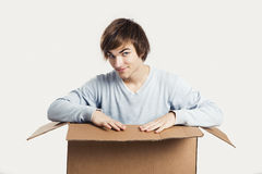 Man inside a card box Royalty Free Stock Photo
