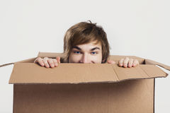 Man inside a card box Stock Photo