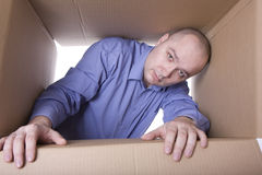 Man inside cardboard box Royalty Free Stock Photos