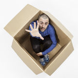Man inside a cardboard box for help Royalty Free Stock Photos