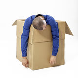 Man inside a cardboard box Stock Photos