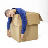 Man inside a cardboard box Stock Photo