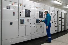 Man is inside electrical energy distribution substation Stock Image