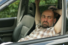 Man inside in his car stock images