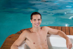 Man inside a jacuzzi Stock Images