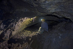 Man Inside Lava Tube Cave In Oregon Royalty Free Stock Photography