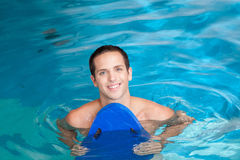 Man inside the pool with floater Stock Photography