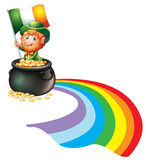 A man inside a pot of gold coins holding flag Royalty Free Stock Photos