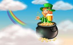 A man inside a pot of gold with a mug of cold beer Stock Photography