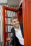 Man inside traditional English red booth Royalty Free Stock Image