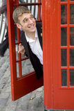 Man inside traditional English red telephone box Stock Image