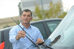 Man inspecting cars wipers Stock Photo