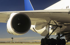 Man inspecting engine of passenger jet Stock Photos