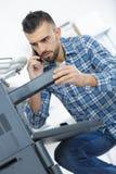 Man inspecting printing machine Royalty Free Stock Photo