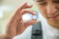 Man inspecting a ring Stock Image