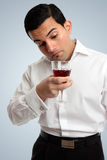 Man inspecting wine Royalty Free Stock Photography