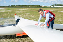 Man inspecting wing glider. Man inspecting wing of glider Royalty Free Stock Images