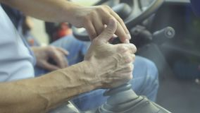 Man inspects gearbox in tractor. Salesman show how to control it. Close-up stock footage