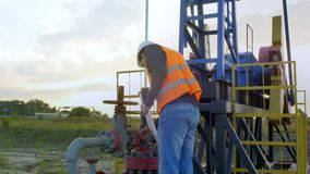 A Man Inspects Oil Rig stock video footage