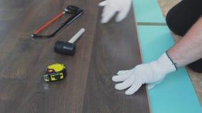 Man install laminate flooring on apartment