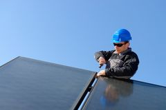 Man installing alternative energy photovoltaic pan Royalty Free Stock Photo